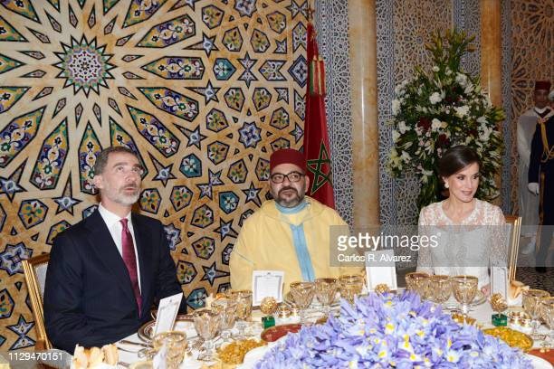 King Felipe VI of Spain King Mohammed VI of Morocco and Queen Letizia of Spain attend a Gala dinner at the Royal Palace on February 13 2019 in Rabat...
