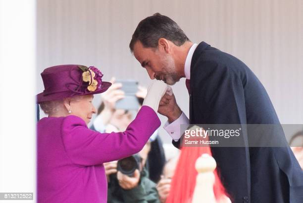 King Felipe VI of Spain kisses the hand of Queen Elizabeth II at a Ceremonial Welcome on Horse Guards Parade during a State visit by the King and...