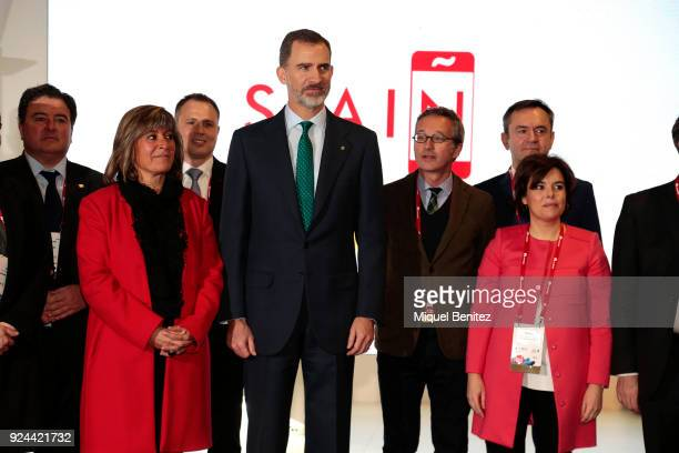 King Felipe VI of Spain , L'Hospitalet's Major Nuria Marin and Soraya Saenz de Santamaria attend the opening of the Mobile World Congress is held in...