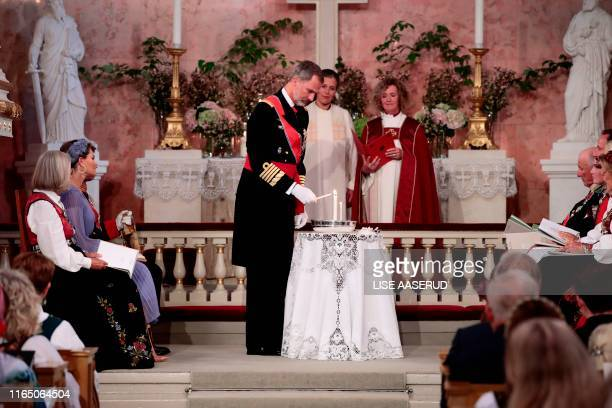 King Felipe VI of Spain lights candles during the confirmation ceremony of Princess Ingrid Alexandra at the Palace Chapel on August 31, 2019 in Oslo,...