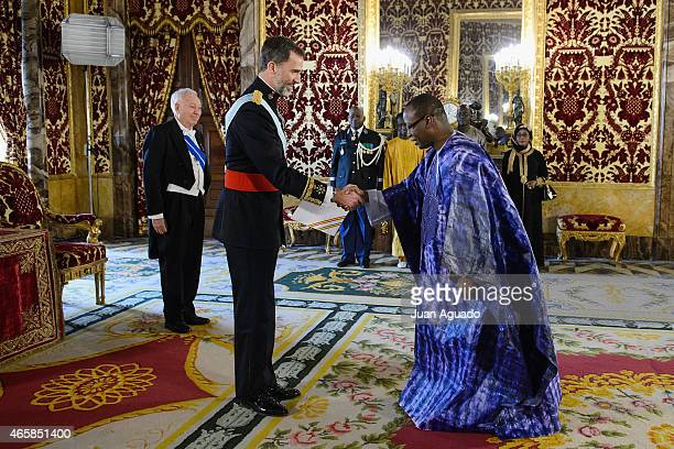 King Felipe VI of Spain meet Ambassador of the Republic of Senegal Abdou Salam Diallo at The Royal Palace on March 11 2015 in Madrid Spain
