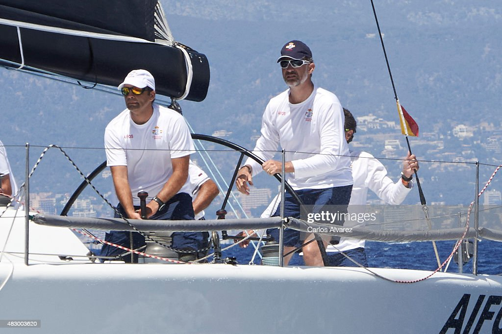 King Felipe VI of Spain (R) on board of the Aifos during the 34th Copa del Rey Mapfre Sailing Cup day 3 on August 5, 2015 in Palma de Mallorca, Spain.