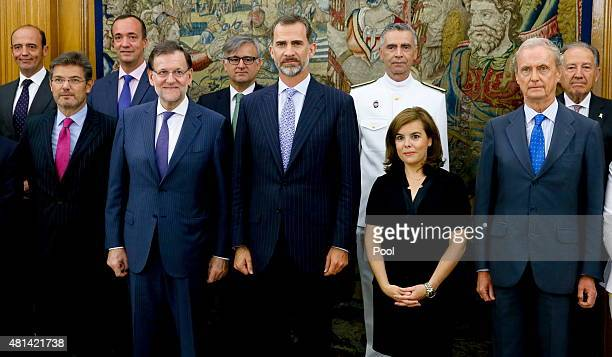 King Felipe VI of Spain poses with the Prime Minister Mariano Rajoy the vice president Soraya Saenz de Santamaria the Minister of Justice Rafael...