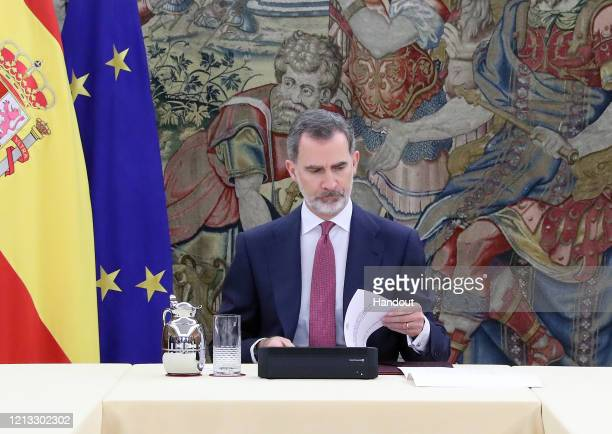King Felipe VI of Spain presides a meeting as part of the Technical Management Committee of Coronavirus at Zarzuela Palace on March 18 2020 in Madrid...