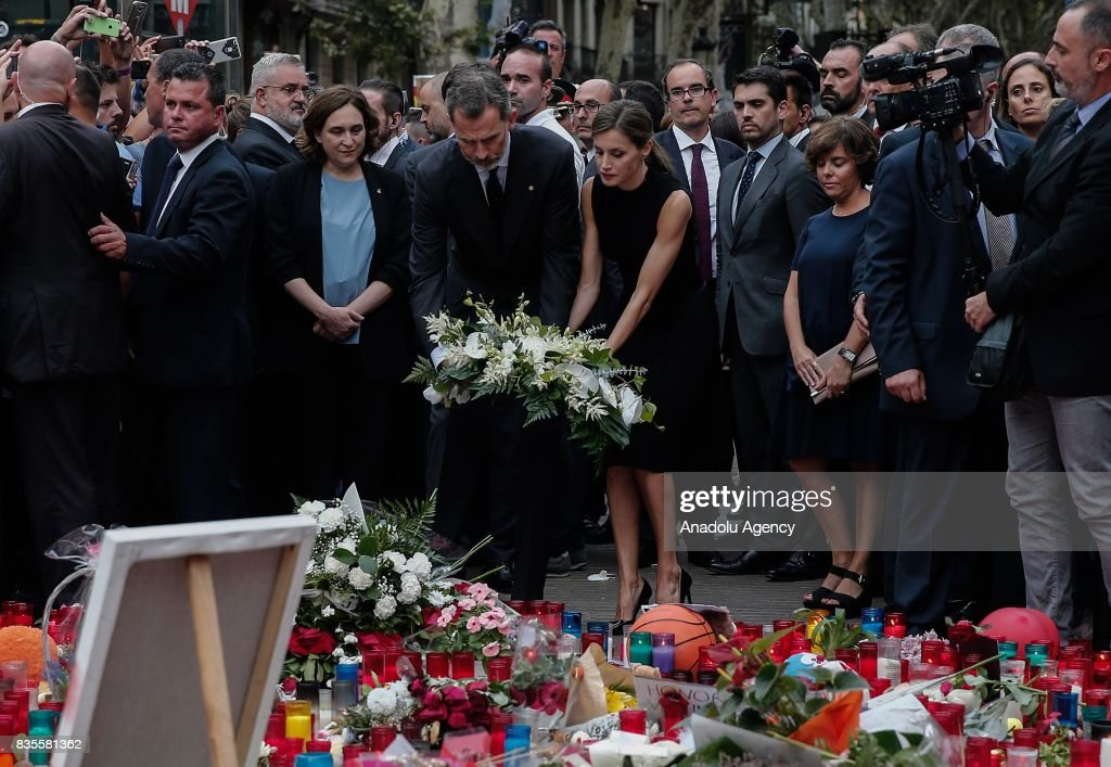 King Felipe VI of Spain (4 L), Queen Letizia (5 L) and the mayor of Barcelona, Ada Colau (3 L) light candles and leave flowers at La Rambla boulevard during a memorial for the victims those who lost their lives in terror attack killing at least 13 people when a white van ploughed into a crowd in central Barcelona, on August 19, 2017, Barcelona, Spain.