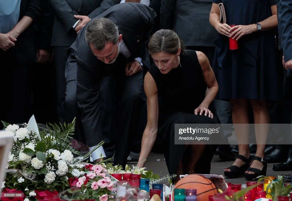 King Felipe VI of Spain (L), Queen Letizia (R) and the mayor of Barcelona, Ada Colau (not seen) light candles and leave flowers at La Rambla boulevard during a memorial for the victims those who lost their lives in terror attack killing at least 13 people when a white van ploughed into a crowd in central Barcelona, on August 19, 2017, Barcelona, Spain.
