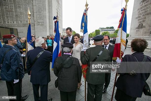 King Felipe VI of Spain, Queen Letizia of Spain and french President Francois Hollande review french soldiers at Arc de Triomphe during the first day...