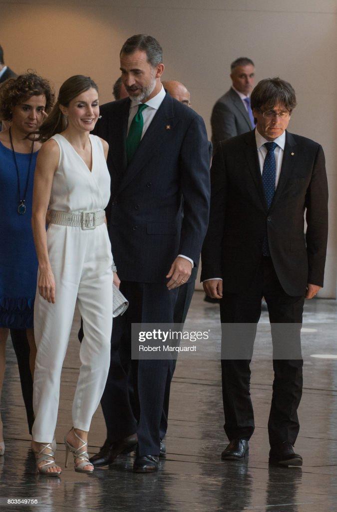 King Felipe VI of Spain (C), Queen Letizia of Spain (2ndL) and President of Catalunya Carles Puigdemont (R) attend the 'Princesa de Girona' foundation awards held at the Palacio de Congressos de Girona on June 29, 2017 in Girona, Spain.