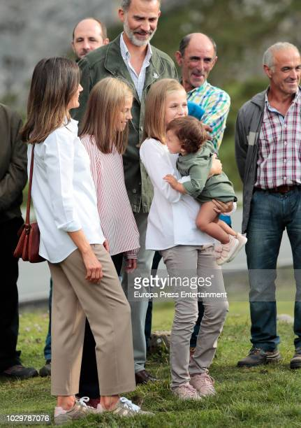 King Felipe VI of Spain, Queen Letizia of Spain, Princess Sofia of Spain and Princess Leonor of Spain carrying a baby attend the Centenary of the...