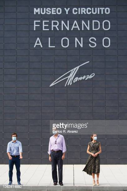 King Felipe VI of Spain Queen Letizia of Spain with Fernando Alonso pose with staff members during a visit to the Fernando Alonso Museum and Circuit...