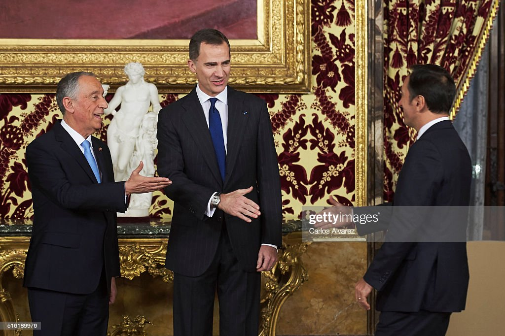 King Felipe VI of Spain (C) receives Portuguese President Marcelo Rebelo de Sousa (L) at the Royal Palace on March 17, 2016 in Madrid, Spain.