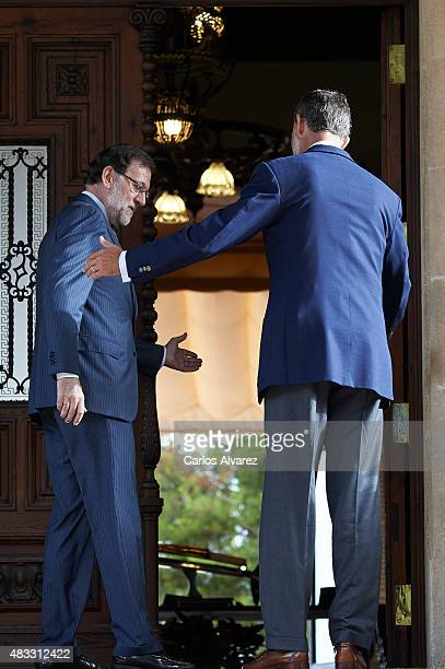 King Felipe VI of Spain receives Prime Minister Mariano Rajoy at the Marivent Palace on August 7 2015 in Palma de Mallorca Spain
