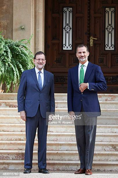 King Felipe VI of Spain receives Prime Minister Mariano Rajoy at the Marivent Palace on August 7, 2015 in Palma de Mallorca, Spain.