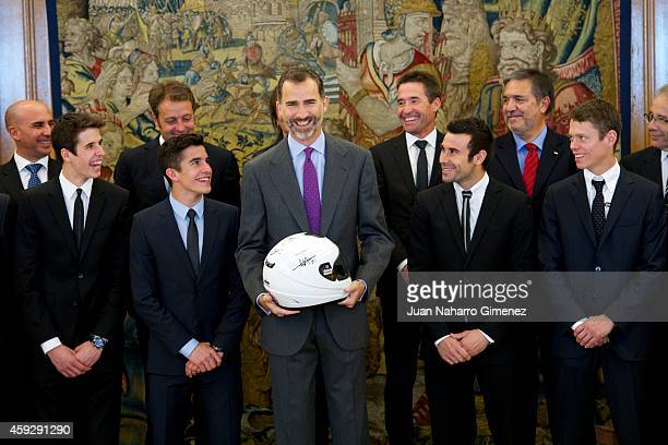 King Felipe VI of Spain receives the motorcycling world champions in 2014 Alex Marquez Alenta Moto2 champion Marc Marquez Alenta MotoGP champion Toni...