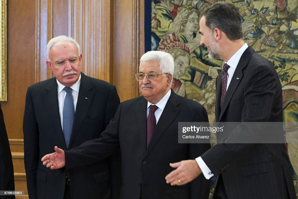 King Felipe VI of Spain (R) reveives Palestinian President Mahmoud Abbas (C) at the Zarzuela Palace on November 20, 2017 in Madrid, Spain.