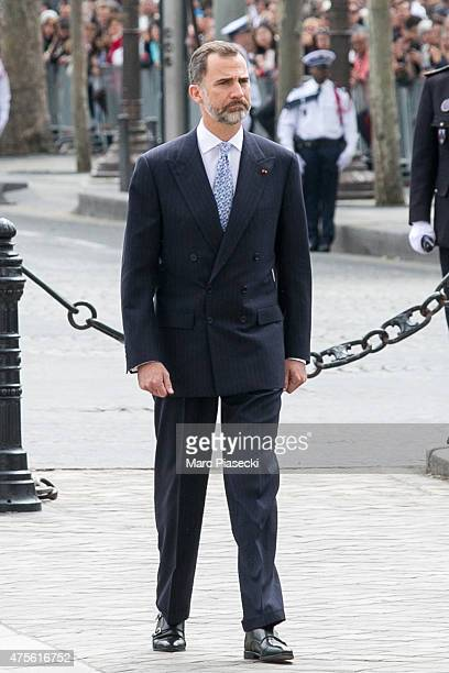 King Felipe VI of Spain reviews french troops at Arc de Triomphe during the first day of a three-days official visit on June 2, 2015 in Paris, France.