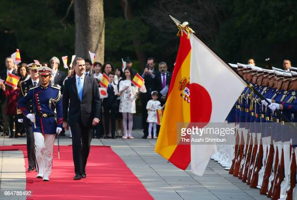 King Felipe VI of Spain reviews the honour guard during the welcome ceremony at the Imperial Palace on April 5, 2017 in Tokyo, Japan.