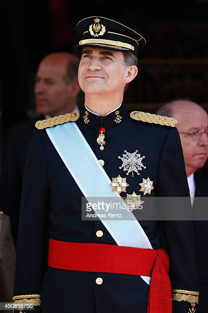 King Felipe VI of Spain reviews walk past a guard of Honor at the Congress of Deputies during the King's official coronation ceremony on June 19 2014...