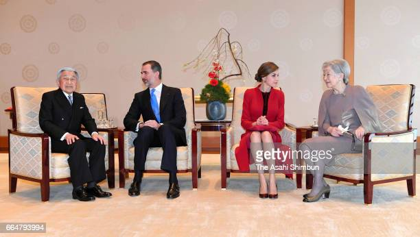 King Felipe VI of Spain talks with Emperor Akihito while Queen Letizia talks with Empress Michiko during their meeting at the Imperial Palace on...