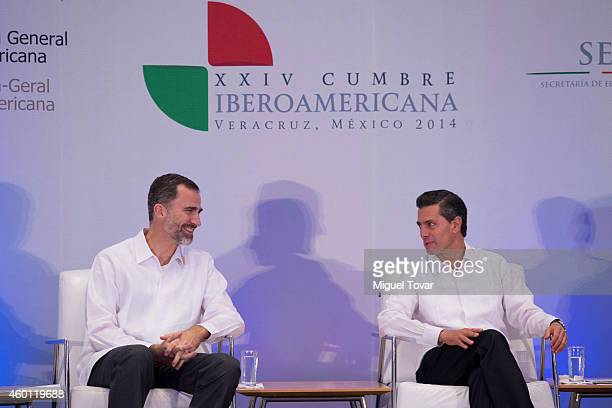 King Felipe VI of Spain talks with Mexican President Enrique Peña Nieto during a meeting with businessmen as part of beroAmerican Summit 2014at...