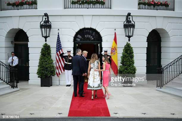 King Felipe VI of Spain US President Donald Trump first lady Melania Trump and Queen Letizia of Spain head into the White House June 19 2018 in...