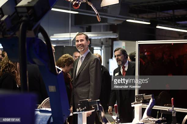 King Felipe VI of Spain watches a robot during his visit to the assembly line at Gestamp Chassis Innovation Center at Autotech Engineering on...
