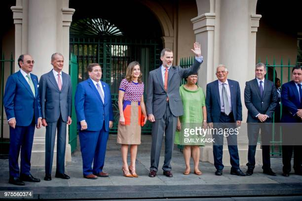 King Felipe VI of Spain waves at the crowd next to Queen Letizia of Spain next to their entourage including Louisiana Lieutenant Governor Billy...
