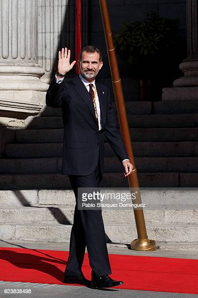King Felipe VI of Spain waves his hand as he arrives to the solemn opening of the twelfth legislature at the Spanish Parliament on November 17 2016...