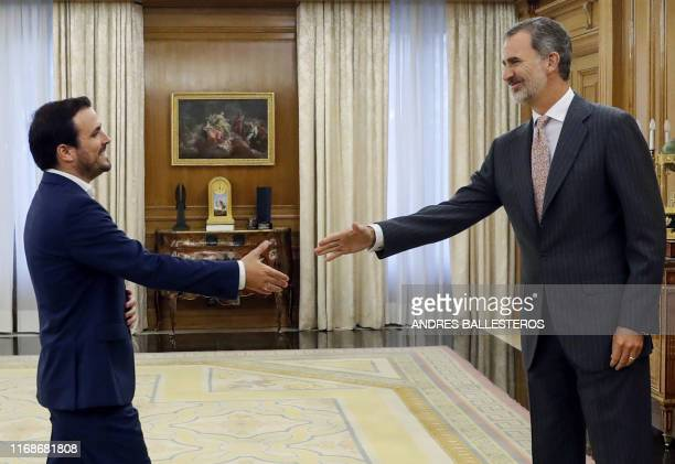King Felipe VI of Spain welcomes the Izquierda Unida leader Alberto Garzon on September 16 2019 at the Zarzuela Palace in Madrid before a meeting in...
