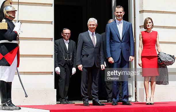 King Felipe VI of Spain with Queen Letizia of Spain and French National Asssemby and Claude Bartolone poses prior to a speech at the French National...