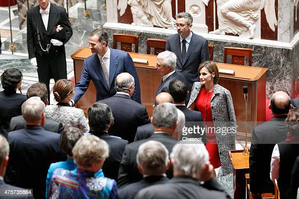 King Felipe VI of Spain with Queen Letizia of Spain and French National Asssemby Claude Bartolone arrives to deliver a speech at the French National...
