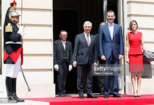 King Felipe VI Queen Letizia of Spain and French National Assembly President Claude Bartolone pose as they arrive at the French National Assembly on...