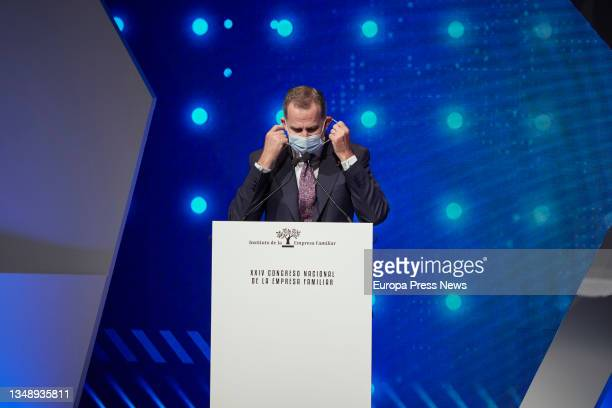King Felipe VI removes his mask to preside over the opening of the XXIV National Congress of Family Businesses at the Baluarte Conference Centre and...