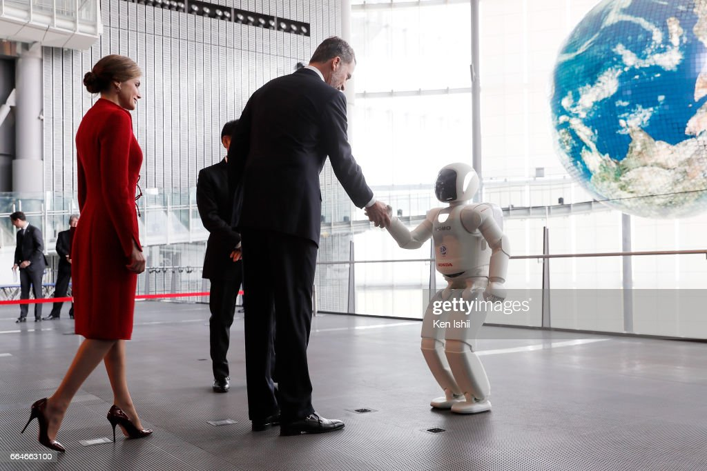 King Felipe VI shakes hands with an ASIMO robot during their visit to the National Museum of Emerging Science and Innovation (Miraikan) on April 5, 2017 in Tokyo, Japan. King Felipe VI and Queen Letizia are visiting Japan from April 4 to April 7, 2017.