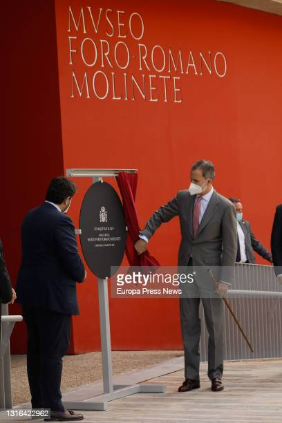 King Felipe VI unveils a commemorative plaque in the presence of the President of Murcia, Fernando Lopez Miras during the inauguration of the new...