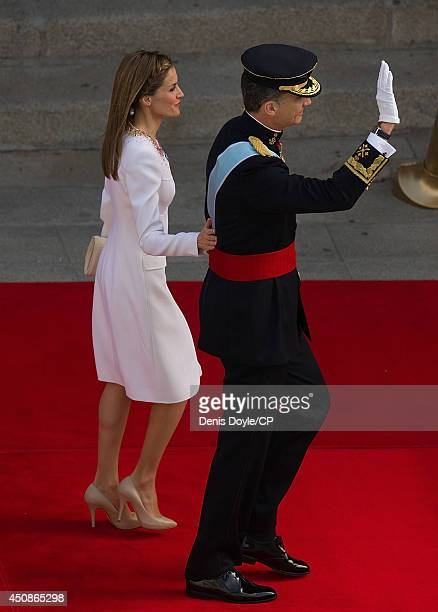 King Felipe Vl waves beside his wife Queen Letizia of Spain on his arrival at the Spanish parliament on June 19 2014 in Madrid Spain The coronation...