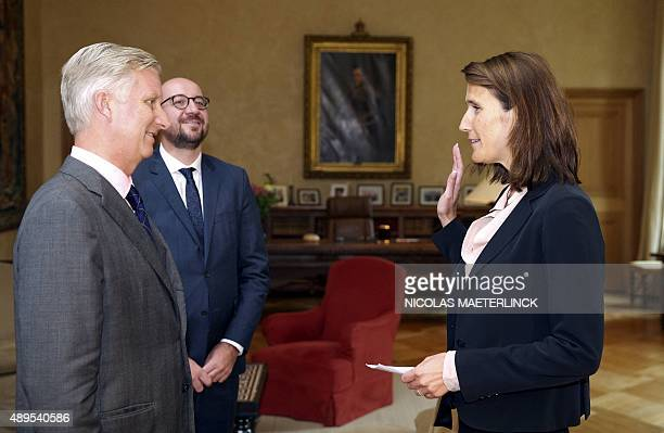 King Filip of Belgium MR Belgian Prime Minister Charles Michel look at Sophie Wilmes during her oathtaking ceremony as new Minister of Budget in the...