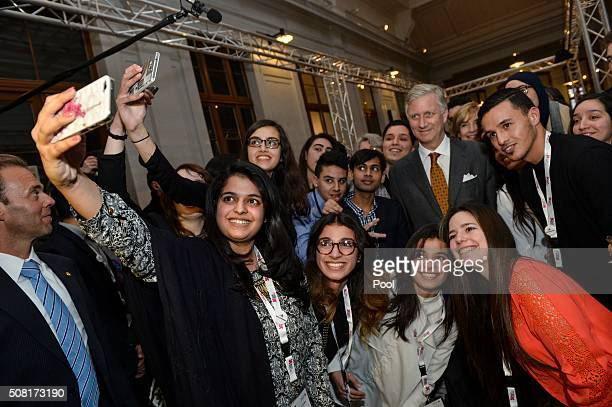 King Filip of Belgium poses with local youth during a royal visit to the Het Huis van Culturen en Sociale Samenhang van SintJansMolenbeek La Maison...