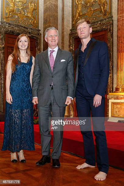 King Filip of Belgium poses with musician Amaryllis Uitterlinden and musician Piet Goddaer during the laureates Linde Declercq from Aarschot and...