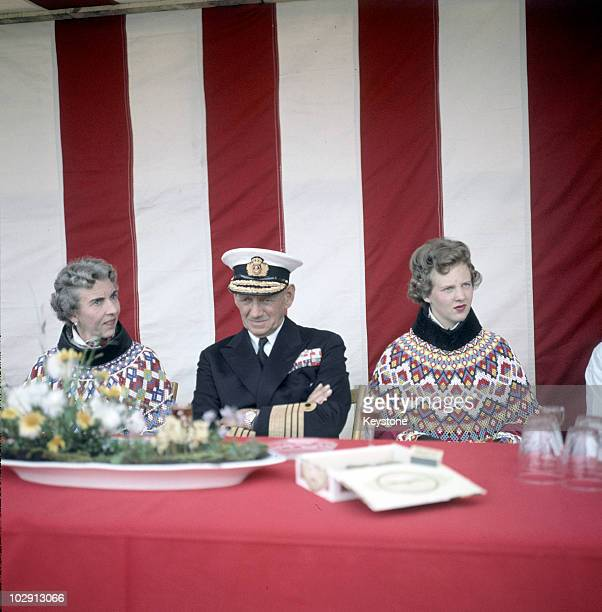 King Frederick IX of Denmark in uniform with his wife Queen Ingrid of Denmark and their daughter Crown Princess Margrethe in Greenland 1960