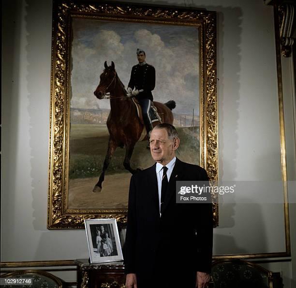 King Frederick IX of Denmark standing before a portrait of a rider on horseback at Amalienborg Palace in Copenhagen Denmark 1969
