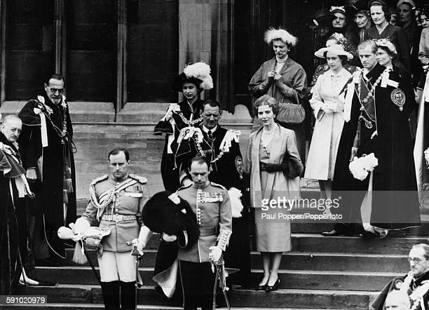 King Frederick IX of Denmark walks down the steps of St George's Chapel in Windsor after being created the 910th Knight of the Garter followed by...