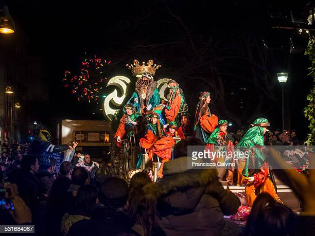 King Gaspar giving away sweets at the Three Kings Day parade Terrassa Barcelona province Spain