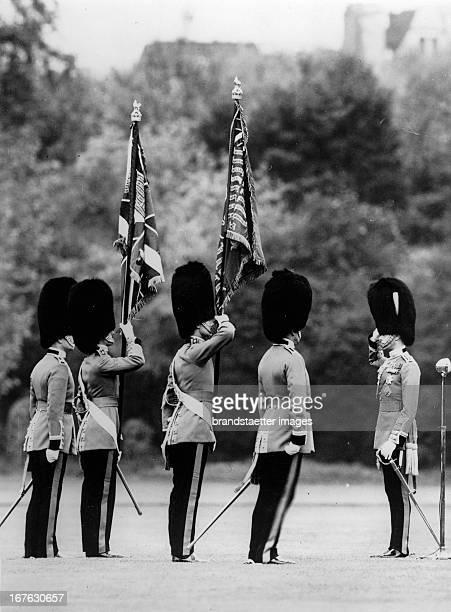 King Georg VI of England during a flag handover in London Photograph About 1937 König Georg VI von England bei einer Fahnenübergabe London...