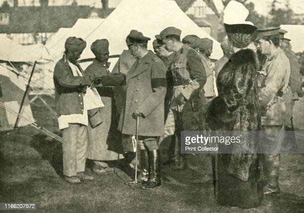 King George and Queen Mary visit wounded soldiers, First World War . 'Wounded Heroes from the Front: Their Majesties visiting one of the Indian...