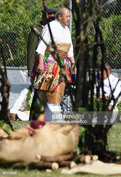 King George Tupou V of Tonga walks past kava plants and slaughtered pigs as he arrives for the taumafa kava ritual and coronation ceremony in the...