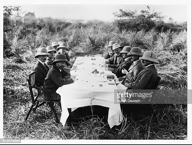 King George V amongst a group of huntsmen who have stopped for refreshments during their trip