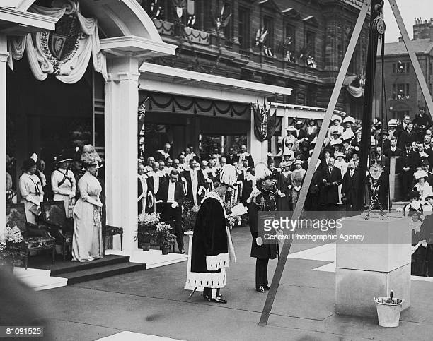 King George V and Queen Mary attend the laying of the foundation stone at the Municipal Buildings Extension of the City Chambers in Glasgow during a...