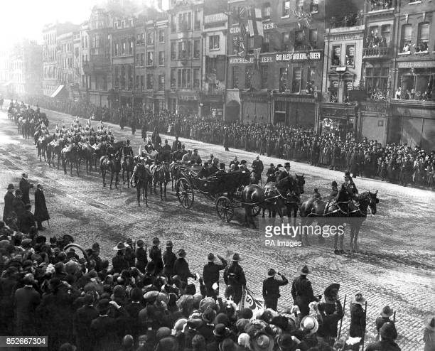 King George V and Queen Mary in procession in the East End. *scanned low res off print, high res available*