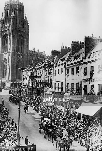 King George V and Queen Mary make their way down Park Street in Bristol having just opened the new Wills Memorial Building part of Bristol University...